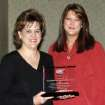 """Oklahoma State Department of Environmental Quality employees Karla Crawford and Bridgett Griffin accept the 2007 Employer of the Year Award from MNTC's HIRE Program at the """"Celebration of Success"""" event held at Moore Norman Technology Center's South Penn Campus.  Community Photo By:  Judy Mosley, MNTC  Submitted By:  Anna, Norman"""