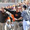 OSU: Oklahoma State University offensive coordinator Dana Holgorsen, left, and head coach Mike Gundy argue with referees over a call during an NCAA college football game against Baylor, Saturday, Nov. 6, 2010, in Stillwater, Okla. (AP Photo/The News Press, Chelcey Adami) ORG XMIT: OKSTI201