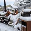 Four inches of snow covers piles of debris from Superstorm Sandy in Point Pleasant Beach, N.J. on Thursday Nov. 8, 2012, a day after a nor'easter hit the storm-weary state. Emergency dunes seemed to have held during the recent storm, and flooding that had been feared did not materialize. (AP Photo/Wayne Parry)