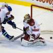 Phoenix Coyotes' Oliver Ekman-Larsson, left, of Sweden, checks Vancouver Canucks' Daniel Sedin, of Sweden, as Coyotes' goalie Mike Smith allows a goal to Canucks' Chris Higgins during the second period of an NHL hockey game in Vancouver, British Columbia, on Sunday, Jan. 26, 2014. (AP Photo/The Canadian Press, Darryl Dyck)