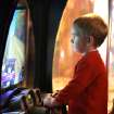 Three-year-old James Hunter concentrates intently on a driving game during a community fair at Andy's Alligator Park in Norman, OK, Saturday, Nov. 12, 2011. By Paul Hellstern, The Oklahoman