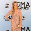 Carrie Underwood arrives at the 47th annual CMA Awards at Bridgestone Arena on Wednesday, Nov. 6, 2013, in Nashville, Tenn. (Photo by Evan Agostini/Invision/AP)