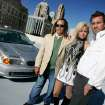 Daniel Orr, Model Amanda Leonard and right, Josh Caldwell pose with the BMW that won the Gumball Rally in Oklahoma City , Okla. September 16 , 2008.  BY STEVE GOOCH, THE  OKLAHOMAN.
