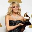 Carrie Underwood poses backstage with the award for best country solo performance for