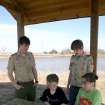 Eagle Scout candidates Eric Oliver (left) and Michael Downs planned, designed, organized and built this lakeside shelter and picnic table on the campus to the J. D. McCarty Center for their Eagle Scout project. Setting up a board game at the picnic table is McCarty Center patient Kali Spencer and her direct care specialist, Savannah Judd. Oliver and Downs are members of the Fox Patrol of Scout Troop 217. The scouts will be awarded their Eagle Scout badge during a court of honor scheduled for May 25, at McFarland Methodist Church.  Community Photo By:  Greg Gaston  Submitted By:  Greg, Norman