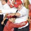 Tony Kanaan hugs team owner Chip Ganassi after winning the IndyCar Series season final 500 mile auto race Saturday, August 30, 2014, at Auto Club Speedway, in Fontana, Calif. (AP Photo/Will Lester)