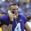 This Sept. 8, 2012 file photo shows TCU quarterback Casey Pachall (4) on the field phone to the booth during a game against Grambling State, in Fort Worth, Texas. Pachall has been suspended indefinitely after he was arrested on suspicion of driving while intoxicated. Coach Gary Patterson announced the suspension Thursday morning, Oct. 4, 2012, hours after police say Pachall was pulled over for running a stop sign near TCU's Fort Worth campus. (AP Photo/Fort Worth Star-Telegram/Paul Moseley) MAGS OUT; (FORT WORTH WEEKLY, 360 WEST); INTERNET OUT