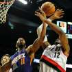 Phoenix Suns power forward Markieff Morris (11) battles for a rebound with Portland Trail Blazers power forward LaMarcus Aldridge (12) during the first quarter of an NBA basketball game on Wednesday, Nov. 13, 2013, in Portland, Ore. (AP Photo/Steve Dykes)