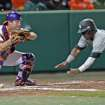 Clemson's Garrett Boulware, left, catches the ball as South Carolina's Shon Carson safely dives for the plate in an NCAA college baseball game on Friday, March 1, 2013, in Clemson, S.C. (AP Photo/Anderson Independent-Mail, Mark Crammer)  GREENVILLE NEWS OUT, SENECA NEWS OUT