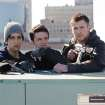 This film image released by Film District shows Josh Peck , left, Josh Hutcherson, center, and Chris Hemsworth in a scene from