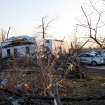 A tornado-damaged home sits amid debris along Main Street, Wednesday, Feb. 29, 2012, in Harveyville, Kan. The small eastern Kansas town of Harveyville took a direct hit from an apparent tornado late Tuesday, injuring 11 people and reducing much of the town to ruins. Authorities say at least 12 people were injured. (AP Photo/John Hanna) ORG XMIT: RPJH101