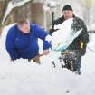 James Farley of Hockessin digs over a foot of snow from his sidewalk and driveway with the help from his dad, Brandt as snow will continue to fall in New Castle County, Thursday, Feb, 13, 2014, in Hockessin, Del. (AP Photo/The News Journal, Suchat Pederson)