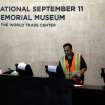 A technician readies computers at the National Sept. 11 Memorial Museum, Wednesday, May 14, 2014, in New York. The museum is a monument to how the Sept. 11 terror attacks shaped history, from its heart-wrenching artifacts to the underground space that houses them amid the remnants of the fallen twin towers' foundations. It also reflects the complexity of crafting a public understanding of the terrorist attacks and reconceiving ground zero.  (AP Photo)