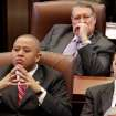 Three legislators listen to Gov. Brad Henry deliver his yearly State of the State message to a joint session of lawmakers in the House chambers at the state capitol Monday afternoon, Feb, 1, 2010.  Photo by Jim Beckel, The Oklahoman