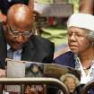 A man and a woman look at the program during the service.  About 2,500 people celebrated the life and legacy of Oklahoma City civil rights pioneer Clara Mae Shepard Luper  during a lively service in the Cox Convention Center that lasted more than three hours, Friday,  June 17, 2011.  Luper died  last week at the age of 88. Photo by Jim Beckel, The Oklahoman