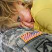 Chief Warrant Officer 3 Danny Collins of Purcell holds one of his seven grandchildren after the 45th Infantry Brigade Combat Team Deployment Ceremony in downtown Oklahoma City, Wednesday, Feb. 16, 2011. Paige Collins, 3, of Davis, OK, lays her head against her grandfather's uniform. The girl's father was serving in Iraq when she was born. Four months after he returned home from duty, he was killed in a motorcycle crash.  This will be Collins' third deployment in the last 20 years. Collins said that at one point, he and three sons were serving in the military. One of his sons is deploying with the Guard group today. Photo by Jim Beckel, The Oklahoman