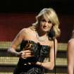 Carrie Underwood accepts the award for best country solo performance for