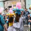 Leah, 11, foreground second from left, and her friend Rachel, 10, foreground second from right, both from New Jersey, pose for photographers with others wearing hats as they take part in the Easter Parade along New York's Fifth Avenue Sunday April 24, 2011. (AP Photo/Tina Fineberg)