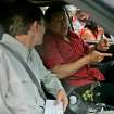 In this June 10, 2007 photo, Venezuela's President Hugo Chavez, right, speaks with AP reporter Ian James who sits in the passenger seat of a Toyota 4 Runner in San Fernando de Apure, Venezuela. During more than eight years covering Venezuela, James says he has gained more street smarts, become a tougher, more resourceful reporter and developed a deep affection for Venezuela, a country where events often collide in unpredictable and dramatic ways and where a wide gap frequently separates the reality on the street from the socialist-inspired dreams that Chavez has instilled in his followers. (AP Photo/Fernando Llano)