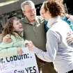 Abby Freeman, of Washington DC (left) and other supporters,  get a hug from Oklahoma City resident Paul Young after he left his office downtown to celebrate with supporters of Senate Bill 1067 outside Chase Tower in Oklahoma City on Tuesday, March 9, 2010. Young, who works downtown said he first heard of the bill after he saw people holding signs in Oklahoma City. On Tuesday, Oklahoma Sen. Tom Coburn lifted his hold, allowing Senate bill1067 to proceed. Photo by John Clanton, The Oklahoman ORG XMIT: KOD
