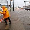 FLASH FLOODS / TORRENTIAL RAIN / FLOOD / FLOODING: A city worker attaches a