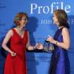 Caroline Kennedy, right, presents former Arizona congresswoman Gabrielle Giffords the John F. Kennedy Profile in Courage Award at the JFK Library in Boston, Sunday, May 5, 2013. (AP Photo/Michael Dwyer)