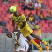 Ghana's Mubarak Wakaso, left, fights for the ball with Mali's Mohamed Sissoko during their African Cup of Nations Group B soccer match in Port Elizabeth, South Africa, Thursday, Jan. 24, 2013. (AP Photo/Schalk van Zuydam)