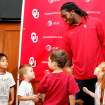OU defensive back Quinton Carter was named to the AFCA Good Works team on Tuesday. Carter was surprised with the award by a class of children Carter