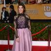 Mayim Bialik arrives at the 20th annual Screen Actors Guild Awards at the Shrine Auditorium on Saturday, Jan. 18, 2014, in Los Angeles. (Photo by Jordan Strauss/Invision/AP)