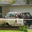 A vehicle is dusted for prints in the driveway of a home on the 8800 block of Oakdale Avenue near Nordhoff Street Wednesday, March 27, 2013, in Northridge, Calif., where 10-year-old girl disappeared during the night. Los Angeles police say the girl has been located. Sgt. Rudy Lopez says she was apparently spotted by someone who recognized her from information that had been publicized and contacted the Police Department. She was found at midafternoon outside a Starbucks store about six miles from her home. (AP Photo/Los Angeles Times, Mel Melcon)