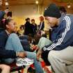 "Player Kevin Durant jokes with a student as she ties her new shoes. Players from the Oklahoma City Thunder NBA basketball team were joined by mascot, Rumble, and Thunder Girls in assisting children at Dunbar Elementary School  in trying on their new Nike athletic shoes donated by SandRidge employees Thursday, Dec. 17, 2009. Each player told the students their favorite holiday song.  Nick Collison: ""Frosty the Snowman"".  Russell Westbrook: ""Jingle Bells"".   Kevin Durant: ""Twelve Days of Christmas"".   Photo by Jim Beckel, The Oklahoman"