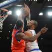 New York Knicks' Tyson Chandler, right, has his shot blocked by the Philadelphia 76ers' Thaddeus Young in the first quarter of the NBA basketball game at Madison Square Garden in New York, Sunday, Nov. 4, 2012. (AP Photo/Henny Ray Abrams)