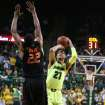 Baylor center Isaiah Austin (21) shoots over Oklahoma State guard Markel Brown (22), left, in the second half of an NCAA college basketball game, Monday, Feb. 17, 2014, in Waco, Texas. (AP Photo/Waco Tribune Herald, Rod Aydelotte)