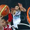 Russia's Alexey Shved, left, drives to the basket under pressure from Argentina's Luis Scola (4) during the men's bronze medal basketball game at the 2012 Summer Olympics  in London on Sunday, Aug. 12, 2012. (AP Photo/Christian Petersen, Pool)