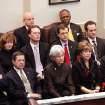 Serious and somber expressions on the faces of the governor's cabinet reflect the austere and grim nature of Gov. Brad Henry's remarks about the state's fiscal condition during his yearly State of the State message to a joint session of lawmakers in the House chambers at the state capitol Monday afternoon, Feb, 1, 2010.  Photo by Jim Beckel, The Oklahoman