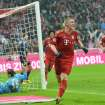 Munich's Bastian Schweinsteiger celebrates after scoring during the  German first division Bundesliga soccer match between FC Bayern Munich and  SV Hamburg   in Munich, Germany, Saturday, March 30, 2013. (AP Photo/Kerstin Joensson)