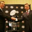 UNIVERSITY OF OKLAHOMA / OU / COLLEGE FOOTBALL / BCS NATIONAL CHAMPIONSHIP GAME / BOWL GAME / BOWL CHAMPIONSHIP SERIES: Florida head coach Urban Meyer, left, and Oklahoma head coach Bob Stoops shake hands in front of the BCS championship trophy during a press conference in Ft. Lauderdale, Fla., Wednesday, Jan. 7, 2009. Oklahoma will play Florida for the NCAA BCS football championship Thursday, Jan. 8. (AP Photo/J. Pat Carter) ORG XMIT: BCS105