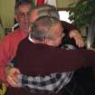 Tim LaCroix, foreground, and Gene Barfield embrace after being pronounced married by Tribal Chairman Dexter McNamara, background left, on the reservation of the Little Traverse Bay Bands of Odawa Indians, Friday, March 15, 2013, in Harbor Springs, Mich. McNamara performed the ceremony after signing a measure approved by the tribal council that allows same-sex marriages on the reservation. (AP Photo/John Flesher)