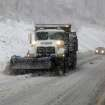 Snow plows move through the mountains of West Virginia Monday, Oct. 29, 2012, in Randolph County, W.Va. Sandy was set to collide with a wintry storm from the west and cold air streaming down from the Arctic. The combination superstorm could menace some 50 million people in the most heavily populated corridor in the nation, from the East Coast to the Great Lakes. (AP Photo/Robert Ray) ORG XMIT: WVRR101