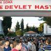 People at the entrance of the local hospital after an explosion and fire  at a coal mine in Soma, in western Turkey, Tuesday, May 13, 2014.  An explosion and fire at a coal mine in western Turkey killed at least one miner Tuesday and left up to 300 workers trapped underground, a Turkish official said. Twenty people were rescued from the mine in the town of Soma in Manisa province but one later died in the hospital, Soma administrator Mehmet Bahattin Atci told reporters. The town is 250 kilometers (155 miles) south of Istanbul. (AP Photo/IHA) TURKEY OUT