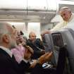 Pope Francis answers reporters questions during a news conference aboard the papal flight on its way back from Brazil, Monday, July 29, 2013. Pope Francis reached out to gays on Monday, saying he wouldn't judge priests for their sexual orientation in a remarkably open and wide-ranging news conference as he returned from his first foreign trip.
