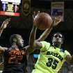 Baylor forward Taurean Prince (35), right,  reaches for a loose rebound with Oklahoma State guard Markel Brown (22), left, in the first half of an NCAA college basketball game, Monday, Feb. 17, 2014, in Waco, Texas. (AP Photo/Waco Tribune Herald, Rod Aydelotte)