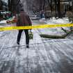 A man steps over downed power line near Dufferin Grove Park in Toronto on Sunday, Dec. 22, 2013 following an ice storm. (AP Photo/The Canadian Press, Ian Willms)