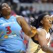 Indiana Fever's Erlana Larkins, right, battles Atlanta Dream's Courtney Paris for rebounding position during their WNBA basketball game, Saturday, May 19, 2012, in Indianapolis. (AP Photo/The Indianapolis Star, Rob Goebel) ORG XMIT: ININS301