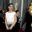 Sandra Bullock arrives before the 84th Academy Awards on Sunday, Feb. 26, 2012, in the Hollywood section of Los Angeles. (AP Photo/Matt Sayles) ORG XMIT: OSC300
