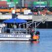 In this Sunday, Aug. 19, 2012 photo, Los Angeles Port Police pull the body of Tony Scott from the water beneath the Vincent Thomas Bridge in San Pedro, Calif. Scott, director of such Hollywood blockbusters as