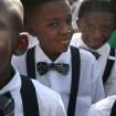 Children from KIPP Zenith Academy prepare to walk down Texas Avenue during the Black Heritage Society's 36th Annual Original Martin Luther King Jr. Parade in downtown Houston, Monday, Jan. 20, 2014. (AP Photo/Houston Chronicle, Johnny Hanson)