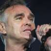 "FILE - In this July 21, 2012 file photo, British rock singer Morrissey, the former front man of the alternative rock group The Smiths, sings during his concert in Tel Aviv, Israel. Animal rights activist and singer Morrissey said he's canceled an appearance Tuesday, Feb. 26, 2013, on Jimmy Kimmel's talk show because cast members of A&E's ""Duck Dynasty"" also were scheduled to appear. (AP Photo/Dan Balilty, File)"