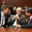 George Zimmerman, right, talks with his defense counsel, Mark O'Mara, left, and Don West, after Judge Debra Nelson informed them that the jury had a questions, on the 25th day of Zimmerman's trial at the Seminole County Criminal Justice Center in Sanford, Fla., Saturday, July  13, 2013. Zimmerman is charged with second-degree murder for the 2012 shooting death of Trayvon Martin.(AP Photo/Joe Burbank, Pool) ORG XMIT: FLJR223