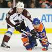 Colorado Avalanche's Gabriel Landeskog, left, battles with the Edmonton Oilers' Shawn Horcoff during the first period of an NHL hockey game in Edmonton, Alberta, on Friday, Dec. 9, 2011. (AP Photo/The Canadian Press, John Ulan)